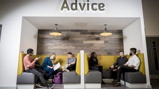 students relaxing in booths