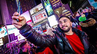 student taking selfie in Leicester Square