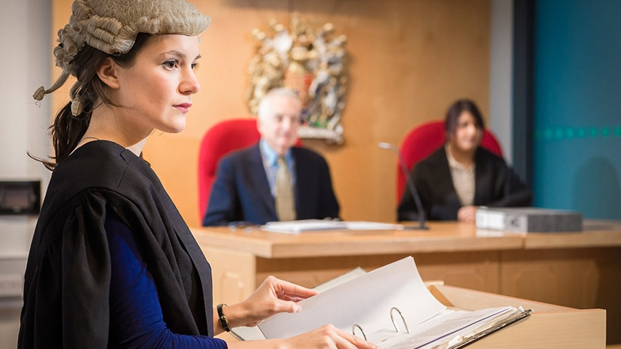 student lawyer in courtroom